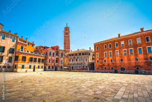Venice cityscape, Campo S Anzolo square and leaning campanile church tower. Italy.