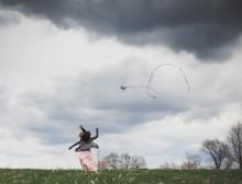 Rear View Of Girl Flying Kite ...