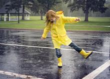 Playful Girl Wearing Raincoat ...