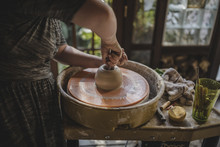 Midsection Of Potter Making Cl...