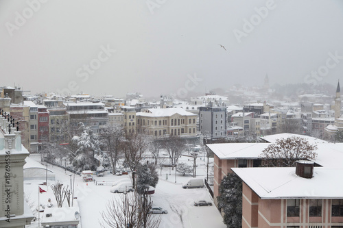 A winter view from the city of Istanbul with houses covered with white snow Poster