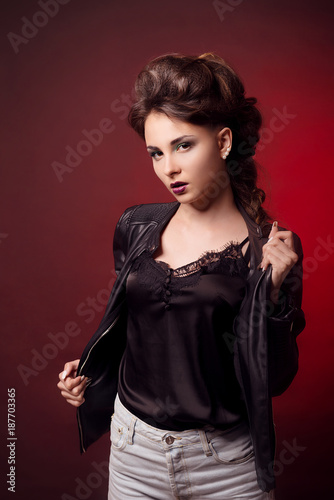 Brunette Girl With Bright Makeup And Stylish Hairstyle In A Leather