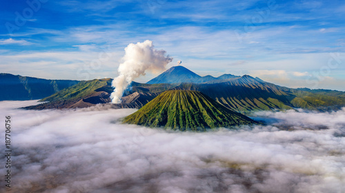 Mountains Bromo volcano (Gunung Bromo) during sunrise from viewpoint on Mount Penanjakan in Bromo Tengger Semeru National Park, East Java, Indonesia.