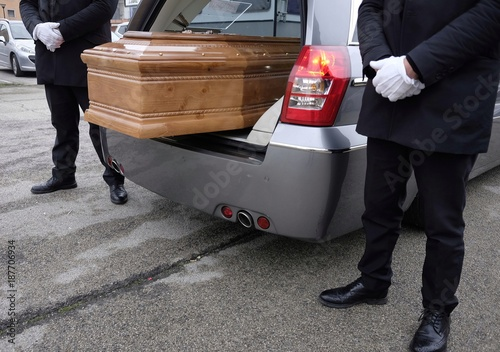 Photo hearse open with coffin