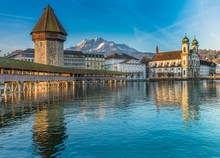 The Kapellbrücke (Chapel Bridge), A Covered Wooden Footbridge Spanning Diagonally Across The Reuss In The City Of Lucerne In Central Switzerland.
