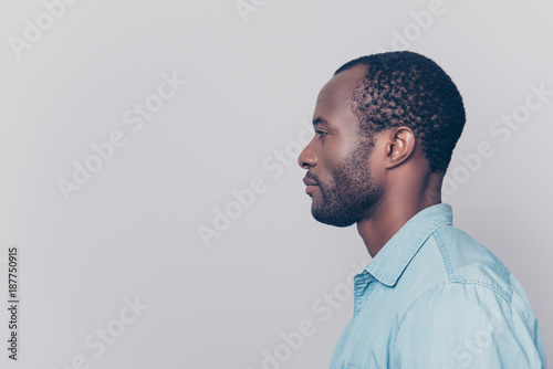 Valokuva  Half-faced side profile view portrait of thoughtful pensive serious confident ha