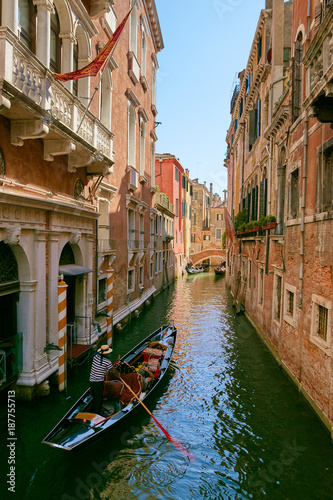 Fotografie, Obraz  Venice, Italy - August 14, 2017: Venice canal with boats and classic buildings