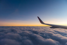 Sky And Clouds With Airplane Wing In Morning