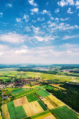 Foto auf Gartenposter Landschappen Little towns and villages with green fields during the sunny day