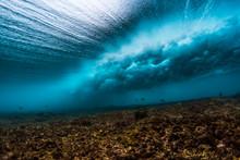 Underwater View Of An Ocean Wave Breaking Over Coral Reef