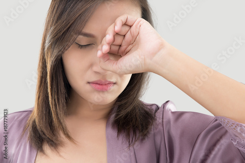 Woman rubs her eye with a finger Canvas Print