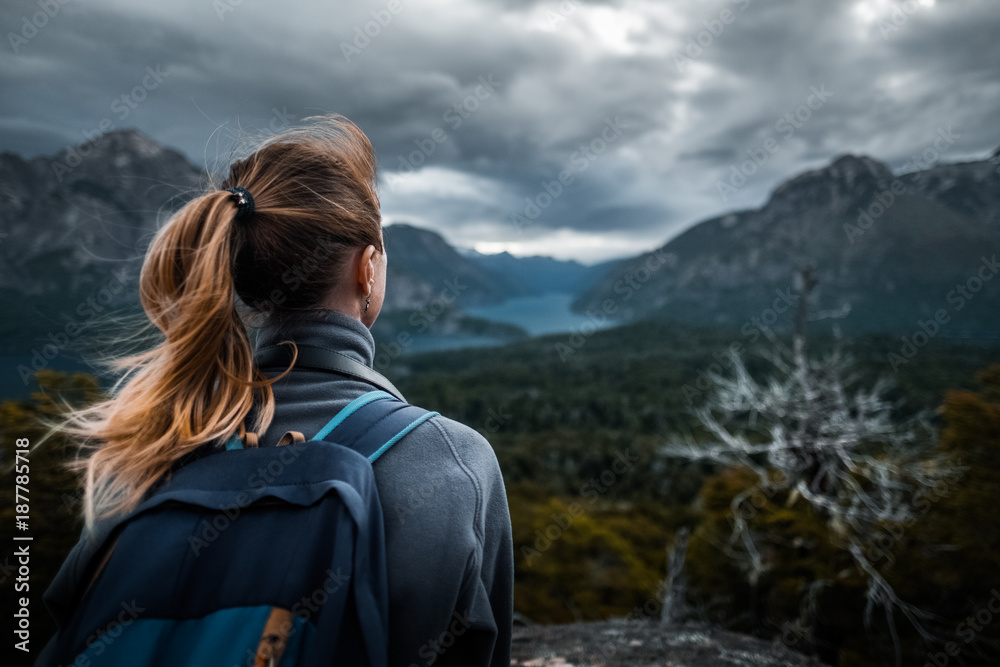 Fototapety, obrazy: Woman hiker enjoys mountains view during bad weather. Patagonia, Argentina