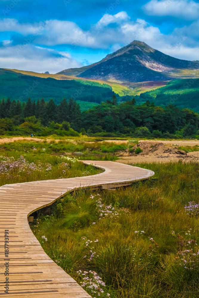 "Fototapeta View of the Goat Fell Mountain, Brodick (Tràigh a' Chaisteil, ""Castle Beach"", Breadhaig) the main town on the Isle of Arran in the Firth of Clyde, Scotland."