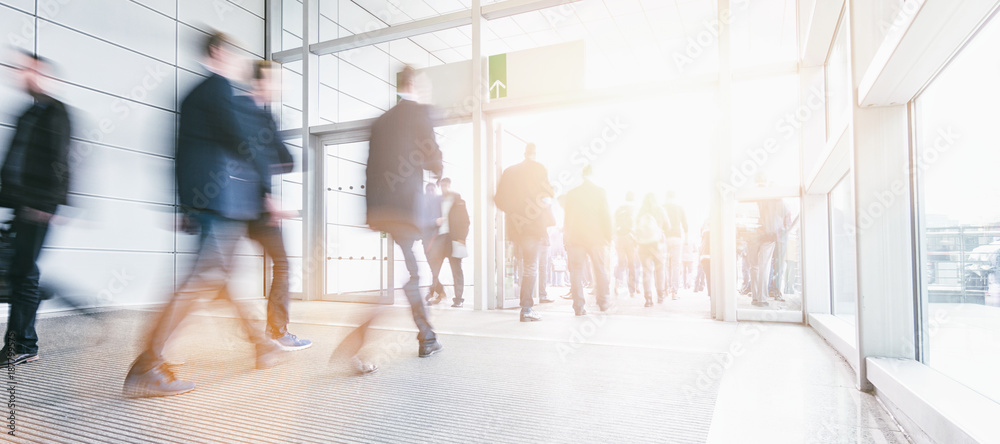 Fototapety, obrazy: Blurred business people at a trade fair entrance