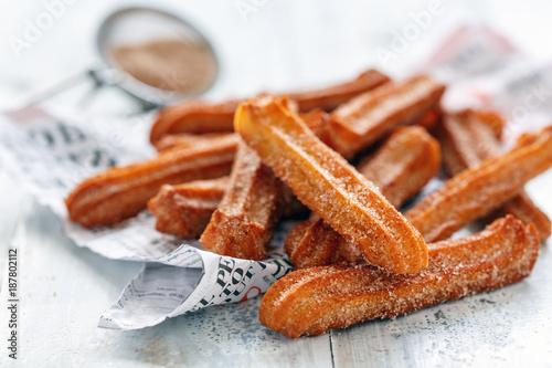 Churros sprinkled with sugar and cinnamon.