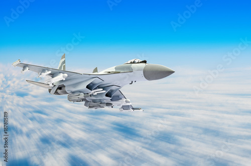 obraz dibond Military fighter aircraft at high speed, flying high in the sky.