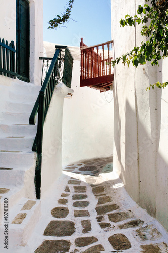 Poster Smal steegje Colored balconies and Railing on the white buildings in a typical alley of kora village, Mykonos island ( greece)