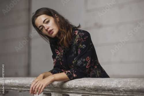 Caucasian woman leaning on railing