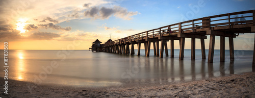 Spoed Foto op Canvas Cappuccino Naples Pier on the beach at sunset