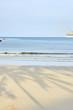 Blue sea. Clear sky. Shadows on sand