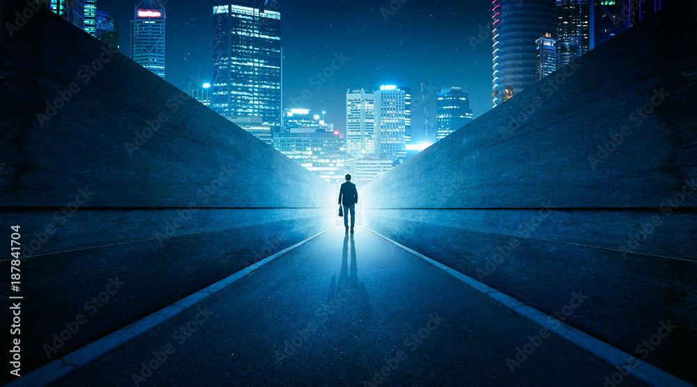 Fototapety, obrazy: Ambitions concept with businessman walking from alley to modern city . Night scene .