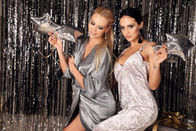 Sexy Women In Luxurious Outfits Posing In Christmas Decorated Studio