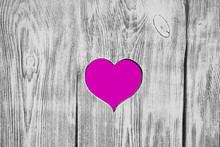 White Heart Carved In A Wooden Board. Background.