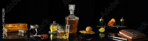 Panorama still life with whiskey and antique objects in retro style