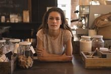 Portrait Of Waitress Standing ...