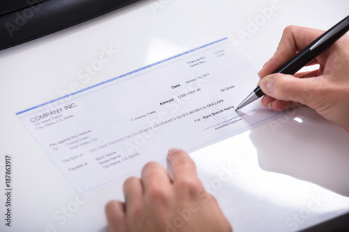 Fototapety, obrazy: Person's Hand Signing Cheque