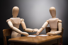 Two Wooden Dummy Figures Making Business Plan