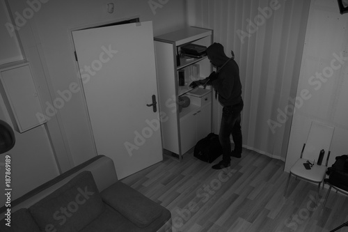 Cuadros en Lienzo Robber Searching House For Valuables