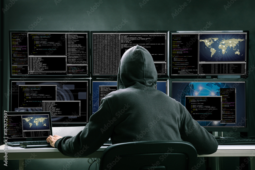 Fototapeta Hacker Using Multiple Computers For Stealing Data