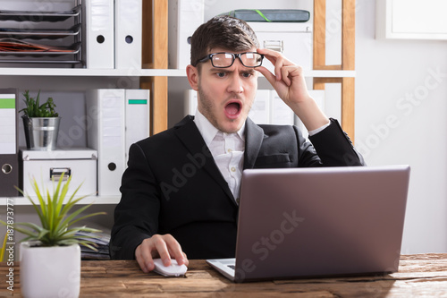 Shocked Businessman Looking At Laptop Wallpaper Mural