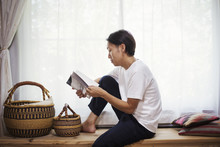 Man Sitting Indoors On A Woode...