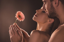 Naked Sensual Lovers Holding Flower, On Brown