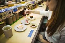 High Angle View Of Woman Eatin...