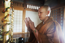 Side View Of Buddhist Monk Wit...