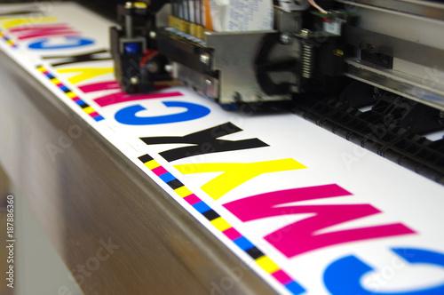 Plotter head printing CMYK Fototapeta