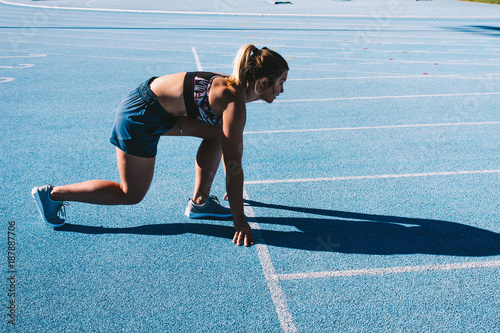 Athlete sprints on running track
