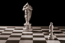 Classic White Bishop And The Same Chess Piece In The Form Of Medieval Figure On The Background