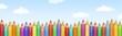 canvas print picture - Viele bunte Buntstifte vor blauem Himmel