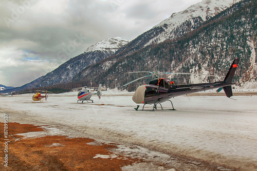 Foto op Aluminium Arctica Three helicopters on a row waiting to take off in the alps switzerland