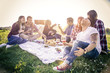 canvas print picture - Happy friends having picnic in a park