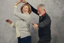 Happy Stylish Elderly Couple D...