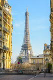 Fototapeta Paryż - View of the Eiffel Tower from a small cobbled dead-end street of the Chaillot hill by a sunny winter afternoon.
