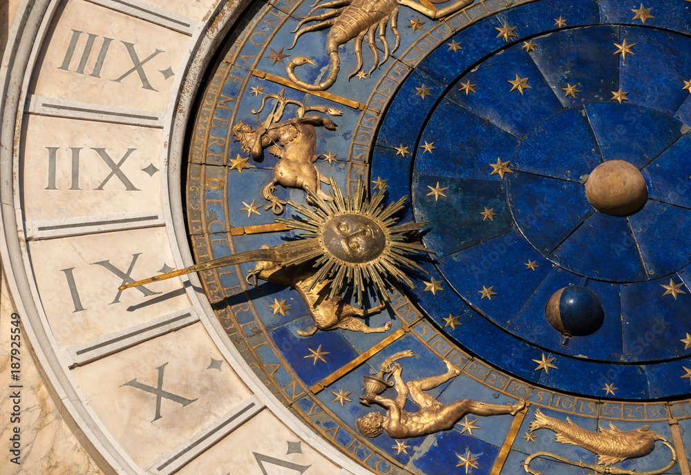 Fototapeta Ancient time and Astrology. Detail of Saint Mark Square renaissance Clock Tower in Venice with zodiac signs, planet and stars (15th century)