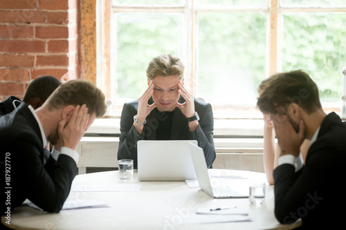 Fotografía Stressed boss and executive team searching problem solution at meeting, partners