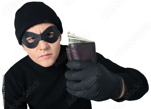 Thief in black wear holding wallet with money on white Wallpaper Mural