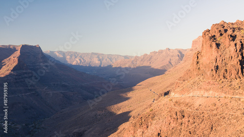 Tuinposter Mountains with canyons during sunset on Gran Canaria island. Retro filtered photography.
